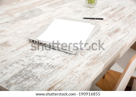 Notes and a Laptop on the Table. - stock photo