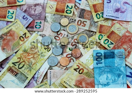 Notes and coins real money in various denominations Brazil - stock photo