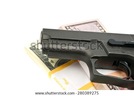 notes and gun on white background closeup - stock photo