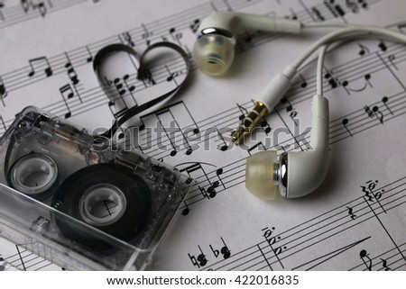 notes background and headphones