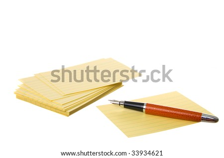notes block and pen isolated on a white background