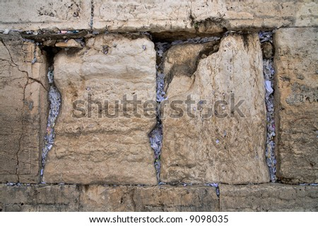 Notes inserted into the Wailing Wall with a plea to God. - stock photo