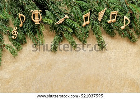 Notes, music instruments. christmas tree brunch  on golden background