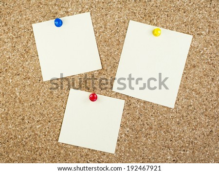 Notes with pins on corkboard