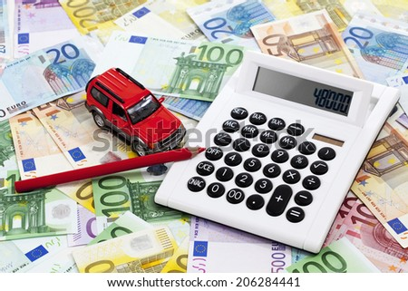 Notes with toy car and calculator - stock photo