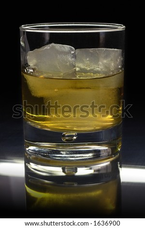 Nothing is better than a glass of whisky on the rocks! - stock photo