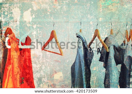 Nothing To Wear Pastel Color Female Clothes on Open Cloth Rail Wooden Hanger Grey Wall Vintage Shabby Effect - stock photo