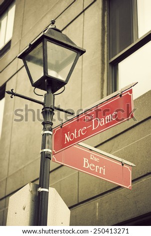 Notre-Dame and Berri Street sign in Montreal - stock photo