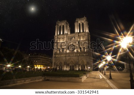 Notre Dame at night. Paris under the light of stars - stock photo