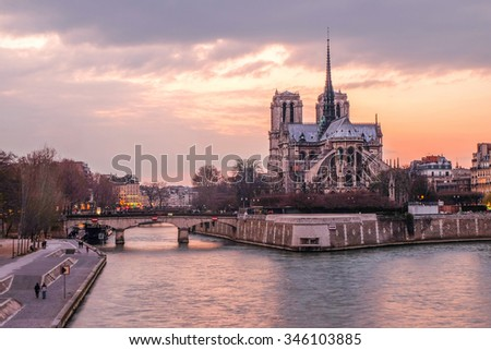 Notre Dame at the river Seine during twilight, Paris, France - stock photo