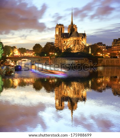 Notre Dame cathedral against sunset with boat in Paris, France - stock photo