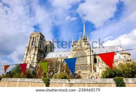 Notre Dame Cathedral in Paris and colorful flags at foreground. Selective focus on the Notre Dame Cathedral. - stock photo