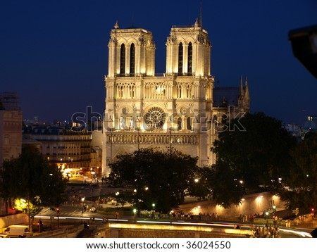 Notre Dame Cathedral In Paris, at night.