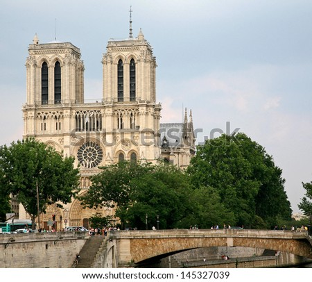 Notre Dame Cathedral in Paris, viewed from a Bridge across the Seine