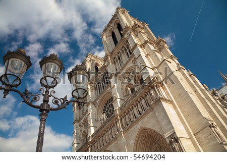 Notre Dame cathedral in Paris with on old street lamp.