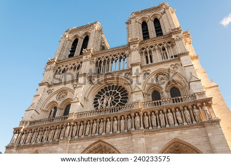 Notre Dame Cathedral with blue sky and sun shine
