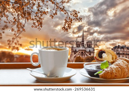 Notre Dame cathedral with coffee and croissants in Paris, France - stock photo