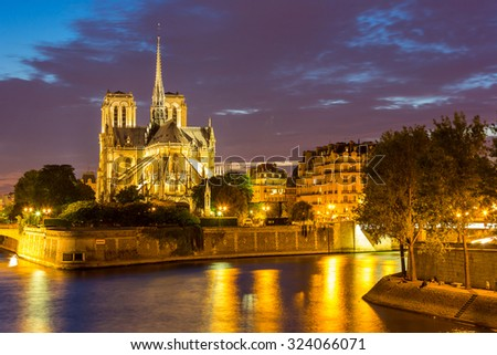 Notre Dame Cathedral with Paris cityscape and River Seine at dusk, France - stock photo