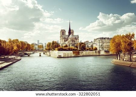 Notre Dame church in Paris and autumn sunny day - stock photo