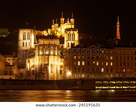 Notre Dame de Fourviere basilica and  St. Jean cathedral both illuminated, in Lyon, France. - stock photo