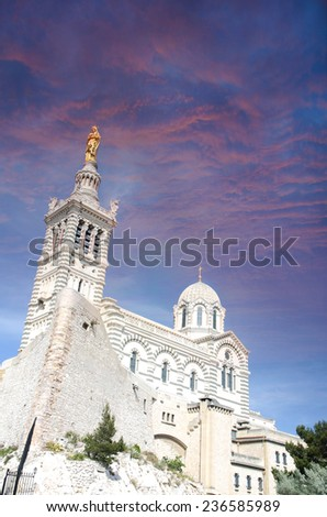 Notre-Dame de la Garde (literally Our Lady of the Guard) during sunset, is a basilica in Marseille, France. This ornate Neo-Byzantine church is situated at the highest natural point in Marseille. - stock photo