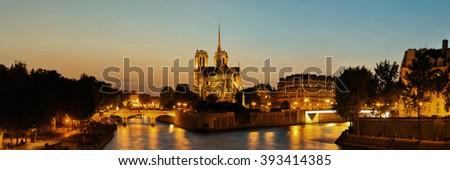 Notre Dame de Paris at dusk panorama over River Seine as the famous city landmark. - stock photo