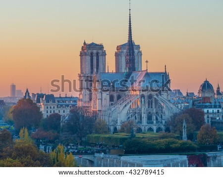 Notre dame de paris by night and the seine river France in the city of Paris in france - stock photo