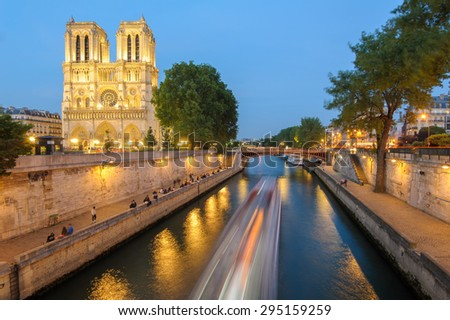 Notre Dame de Paris Cathedral and Seine River at night - stock photo