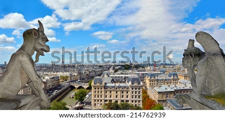 Notre Dame de Paris Cathedral. Famous Chimera (demon) overlooking the Eiffel Tower. Paris, France - stock photo