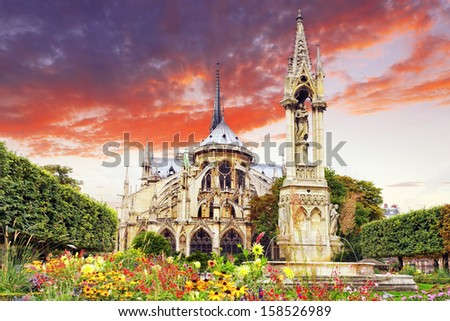 Notre Dame de Paris Cathedral, garden with flowers.Paris. France - stock photo