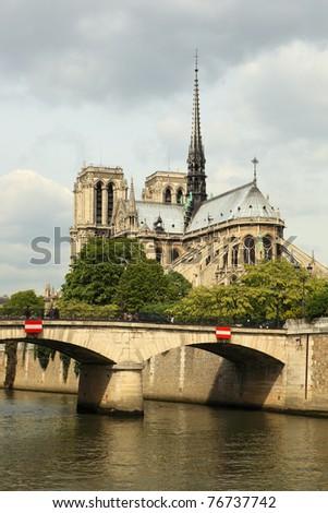 Notre Dame de Paris cathedral on the la seine riversid - stock photo