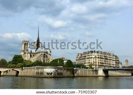 Notre Dame de Paris cathedral on the la seine riverside - stock photo