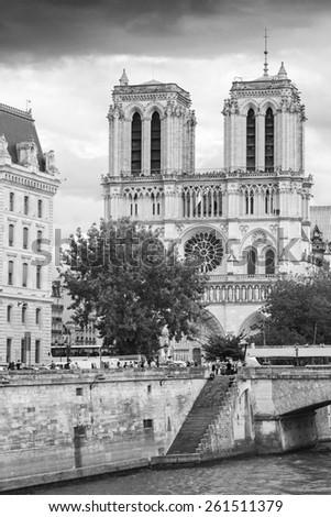 Notre Dame de Paris cathedral. The most popular city landmark of Paris, black and white photo - stock photo
