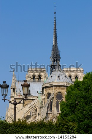Notre-Dame de Paris, gothic cathedral, stands in the heart of the Ile de la Cité. Seen from backwards, through the square Jean XXIII. - stock photo
