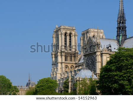 Notre-Dame de Paris, gothic cathedral, stands in the heart of the ?le de la Cit?. Square Jean XXIII in the foreground. - stock photo