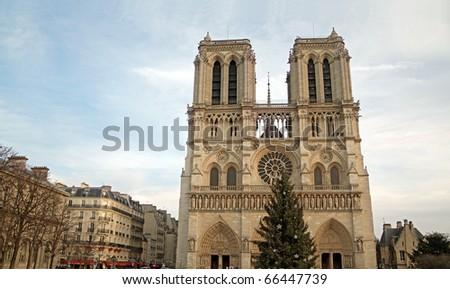Notre Dame de Paris: Notre Dame cathedral in Paris, France under cold winter sky. - stock photo