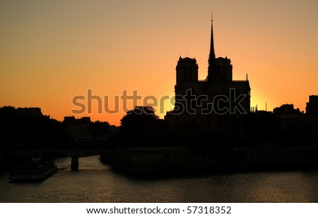 Notre-Dame de Paris silhouette over sunset