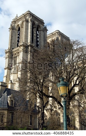 Notre-Dame de Paris.View of southern facade and vintage street lamp in the foreground