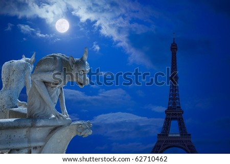 Notre Dame of Paris: Chimeras (demons) looking to the Eiffel Tower under moonlight - stock photo