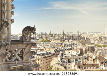 Notre Dame of Paris: Famous Chimera, demon, overlooking the Eiffel Tower at a summer day - stock photo