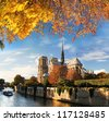 Notre Dame with boat on Seine in Paris, France - stock photo