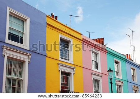 Notting Hill houses in the famous Portobello Road market, west London. - stock photo