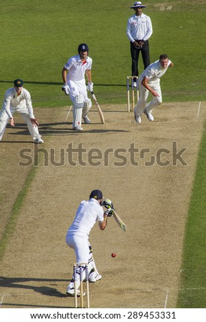 NOTTINGHAM, ENGLAND - July 11, 2013: Australia's Peter Siddle bowls the ball to Kevin Pietersen during day two of the first Investec Ashes Test match at Trent Bridge Cricket Ground.