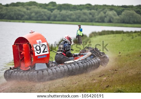 NOTTINGHAM, ENGLAND - JUNE 2: An unnamed driver of an FX1 class racing hovercraft mounts the lakebank during the International championships on June 2, 2012 in Nottingham