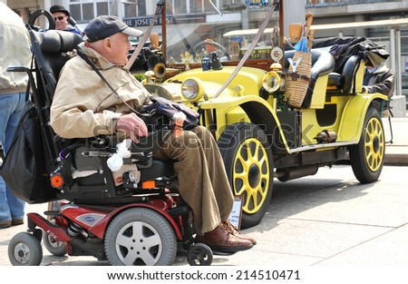NOTTINGHAM, UK - APRIL 29, 2011: People admire Doctor Who's famous car during the vintage cars show in Nottingham - stock photo