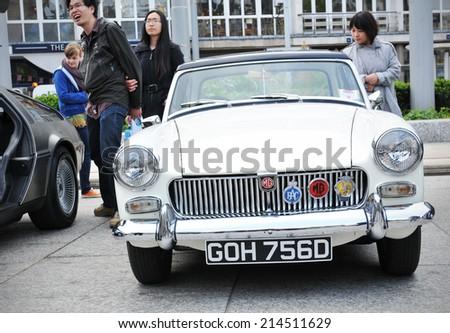 NOTTINGHAM, UK - APRIL 29, 2011: Vintage car on display in Nottingham Old Market Place during the Vintage Cars Festival celebrating the Royal Wedding of Prince William and Kate Middleton - stock photo