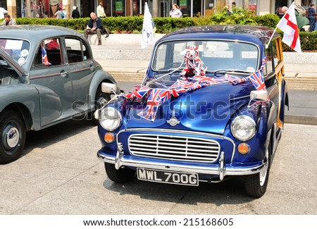 NOTTINGHAM, UK - APRIL 29, 2011: Vintage cars on display in the Old Market Place during the Vintage Cars Festival celebrating the Royal Wedding of Prince William and Kate Middleton - stock photo