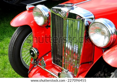 NOTTINGHAM, UK. JUNE 1, 2014: Close up of a red MG vintage car for sale in Nottingham, England. - stock photo