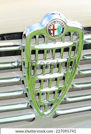 NOTTINGHAM, UK - JUNE 1, 2014: Close up of logo of an Alfa Romeo vintage car for sale in Nottingham, England. - stock photo