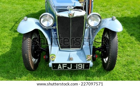 NOTTINGHAM, UK - JUNE 1, 2014: Front view of a pre-war MG vintage car for sale in Nottingham, England. - stock photo